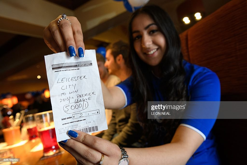 Student Karishma Kapoor holds her betting slip with odds of 5000/1 if Leicester City win the Premiership title, ahead of watching the Leicester City vs Manchester United match in Leicester on 1 May, 2016. Kapoor, aged 20, originally placed a ��2 bet with Ladbrokes and is set to win ��10,000 if her team wins today. / AFP / LEON