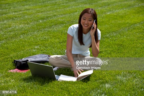 student laying down outside : Stock Photo