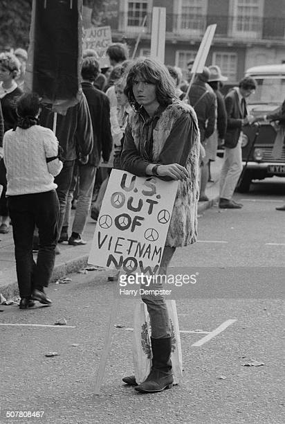 A student leans on his placard during an antiVietnam War demonstration at the US Embassy in London England 1969