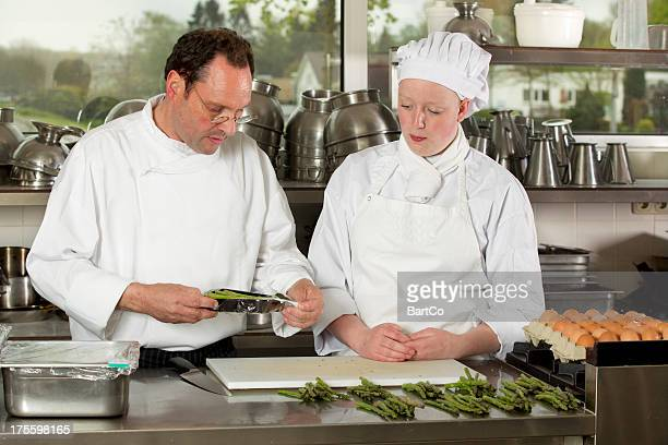 Student learn about cooking from an experienced instructor