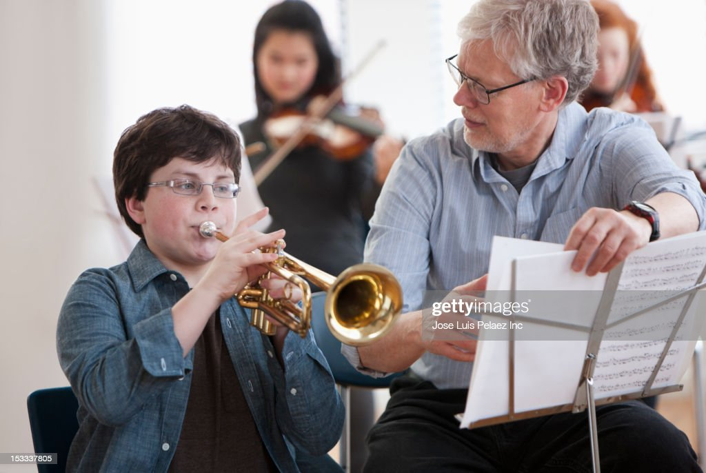 Student learning to play the trumpet : Stock Photo