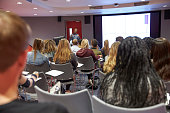 Student lecture in modern university classroom, back view