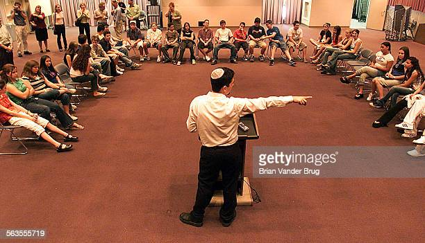 Student life coordinator Hyim Brandes center addresses freshmen at the New Community Jewish High School during a student orientation day held at the...