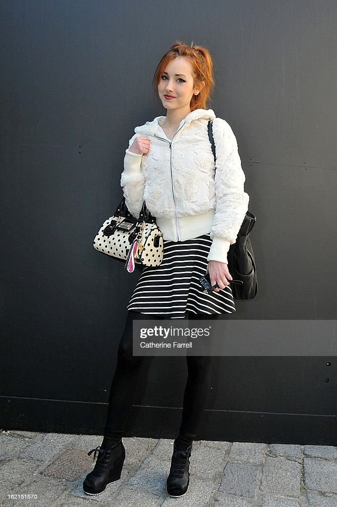 Student Lindzey Cortner wearing a blouson vintage jacket from St. Louis, Assymetric striped skirt from Argen B accessorised with River Island shoes shoes at London Fashion Week Fall/Winter 2013/14 on February 19, 2013 in London, England.