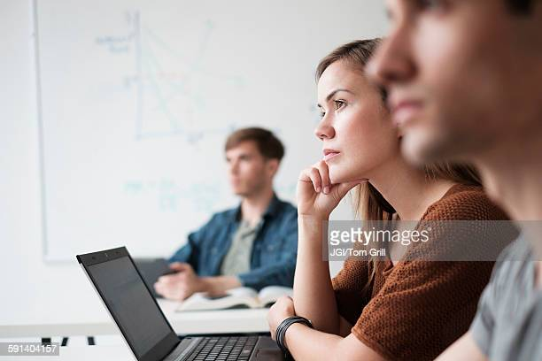 Student listening in college classroom