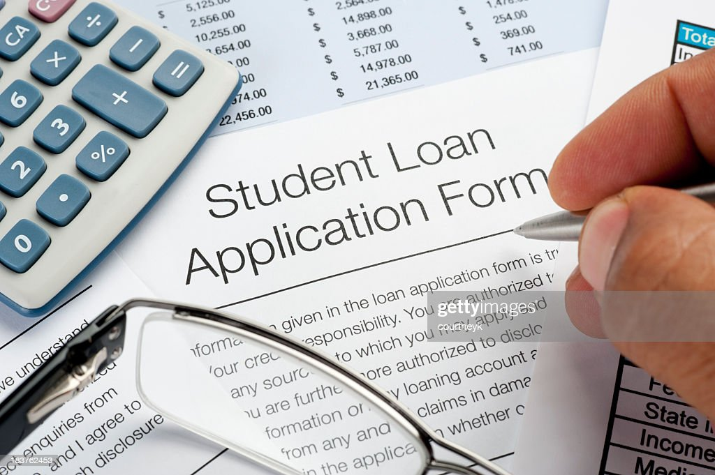 Student Loan Application Form With Pen Calculator And Writing H