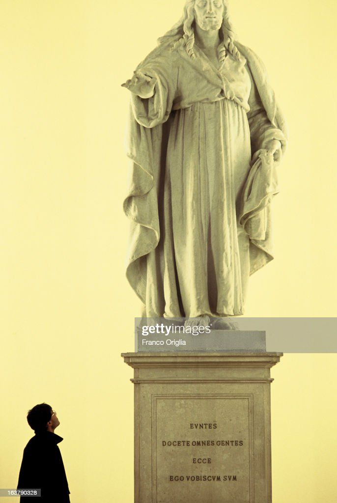 A student looks at a statue of Jesus with the inscription in Latin 'Go and teach all the people, I am with you' taken at Gregoriana University in 1991 in Rome, Italy. The Argentinian Cardinal Jorge Mario Bergoglio, was ordained for the Jesuits on 1969 at the Theological faculty of San Miguel and was elected as Pope Francis on March 13, 2013 as the first ever Jesuit Pontiff. The Society of Jesus, founded on 1540 by the Spanish , Ignatius of Loyola's, is a Christian male religious order of the Roman Catholic Church. The society is engaged in evangelization and apostolic ministry in 112 nations and on six continents. Jesuits operate in education (founding schools, colleges, universities and seminaries), intellectual research, and cultural pursuits.