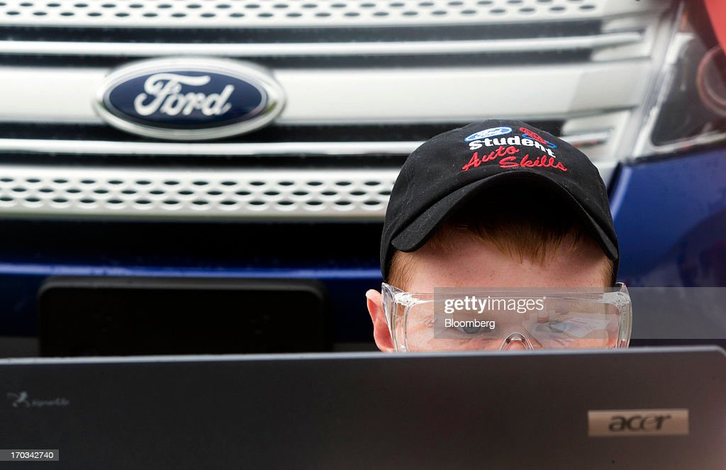 A student looks over diagnostic information on a laptop while repairing a Ford Motor Co. Explorer at the National Finals of the Annual Ford/AAA Student Auto Skills Competition at the Ford World Headquarters in in Dearborn, Michigan, U.S., on Tuesday, June 11, 2013. Job openings in the U.S. fell in April, showing companies were waiting to assess the effects of higher taxes and reduced government spending before committing to bigger staff increases. Photographer: Ty Wright/Bloomberg via Getty Images