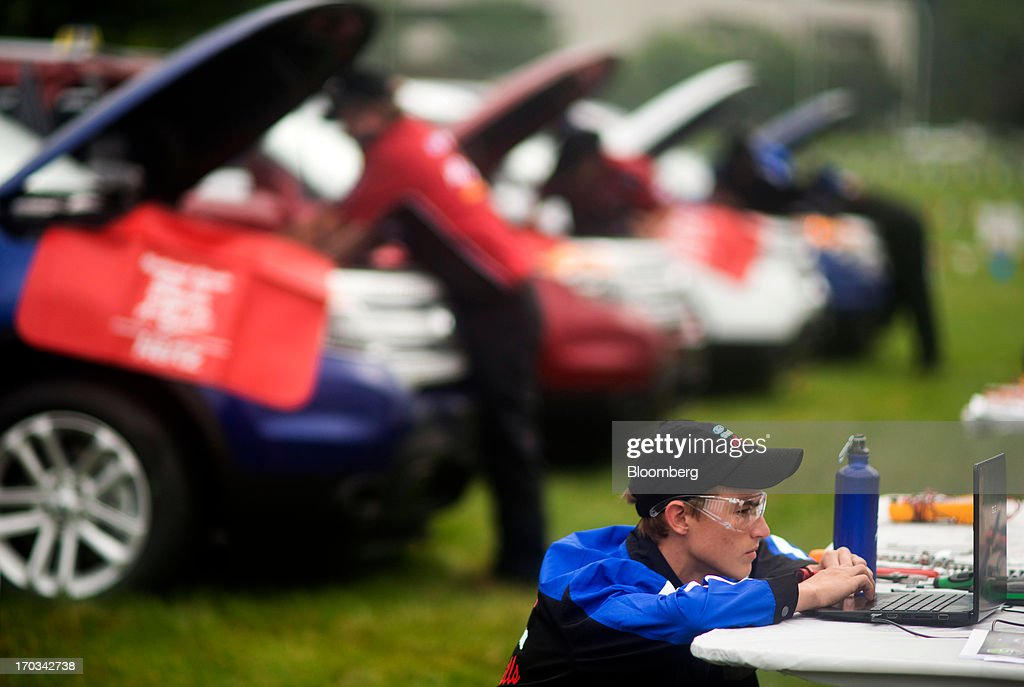 A student looks over diagnostic information on laptops while repairing Ford Motor Co. Explorers at the National Finals of the Annual Ford/AAA Student Auto Skills Competition at the Ford World Headquarters in in Dearborn, Michigan, U.S., on Tuesday, June 11, 2013. Job openings in the U.S. fell in April, showing companies were waiting to assess the effects of higher taxes and reduced government spending before committing to bigger staff increases. Photographer: Ty Wright/Bloomberg via Getty Images