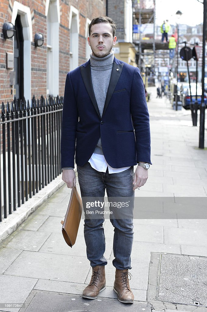 Student Matthew (21) poses wearing and Etro blazer Dolce and Gabbana shirt, Zara roll kneck and Zara trousers with ASOS boots a Longines watch and a Hermes wallet t the Shaun Samson catwalk presentation during London Collection: MEN on January 9, 2013 in London, England.