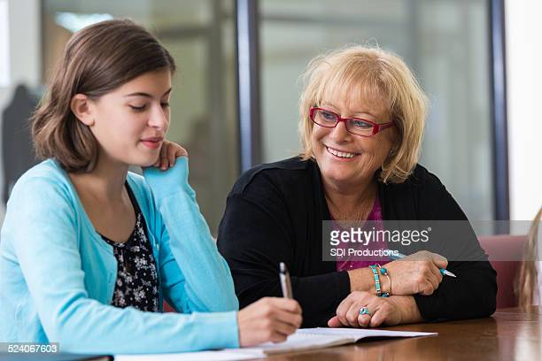 Student meeting with school counselor in office