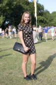 Student Megan Towsey wearing converse trainers Tospshop dress and a Chanel bag at Lovebox 2014 on July 18 2014 in London England