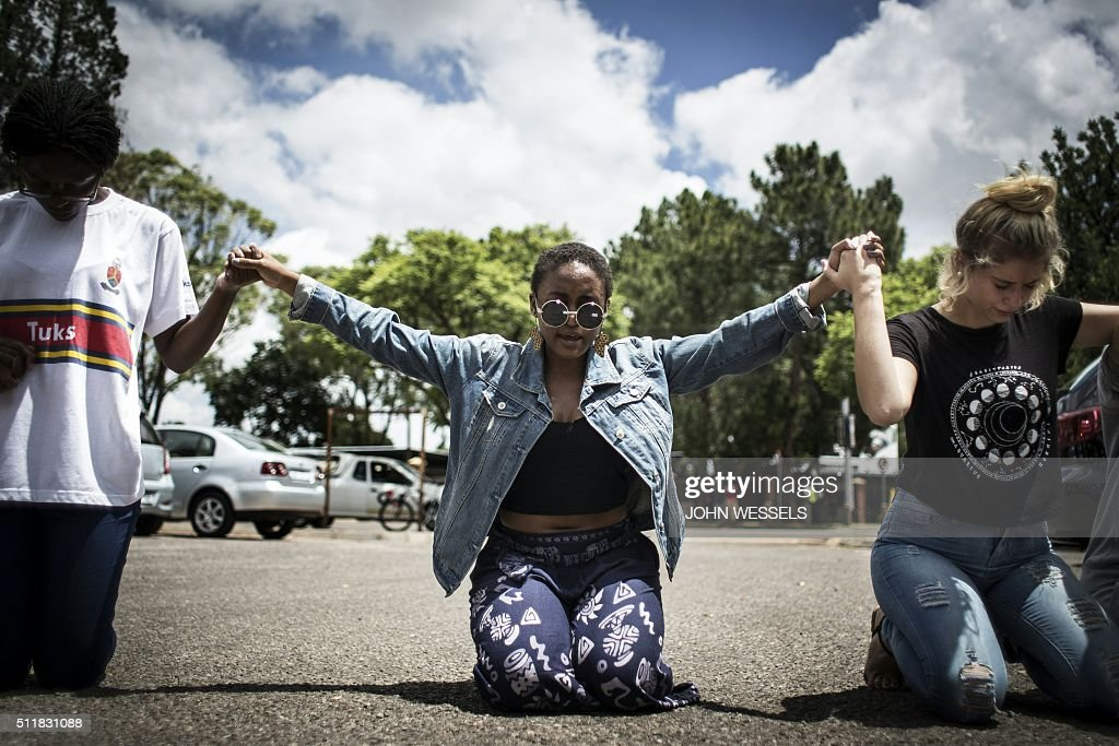 Student members of the Christian Revival Church pray for peace as a protest against the scrapping of the Afrikaans language at the University Of...