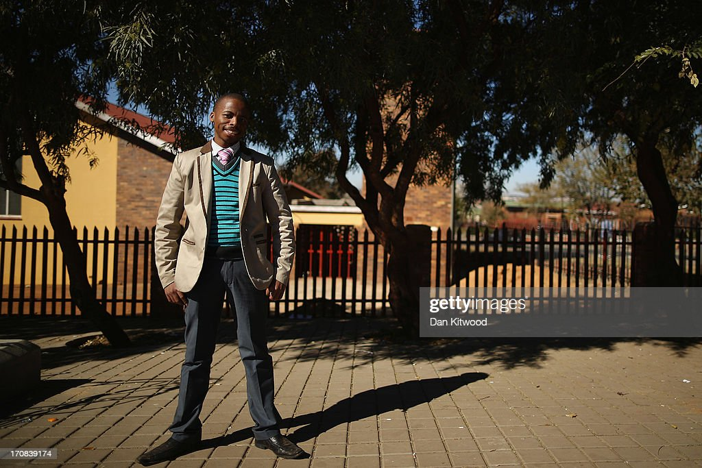 Student Mlungisi Madlala, 25, poses for a portrait by the side of the road in Soweto on June 15, 2013 in Johannesburg, South Africa. Speaking of Nelson Mandela, Mr Madlala said, 'Nelson Mandela is a hero who everyone recognises as one of the people who fought the struggle for democracy'. The former South African President and leader of the anti-apartheid movement has spent over a week in hospital after being admitted for a recurring lung infection.