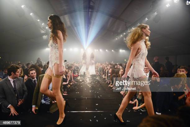 Student models from St Andrews University take part in the 22nd annual charity fashion show on February 15 2014 in St Andrews Scotland This year's...
