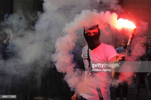 A student of Cairo University lights flare during an anticoup protest in Cairo Egypt on November 17 2014 Photo by Stringer/Anadolu Agency/Getty Images