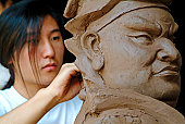Student of sculpture at Shuanglin temple.