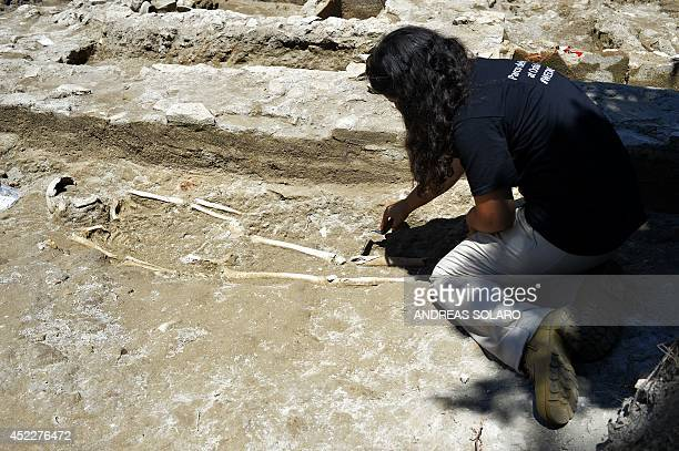 A student of the American Institute for Roman Culture works on a skeleton at the Parco dei Ravennati excavation site in Ostia Antica on July 17 2014...