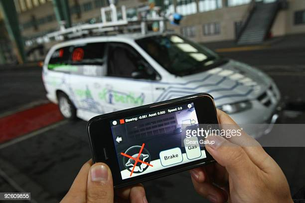 A student of the department for aritificial intelligence at the Freie Universitaet Berlin steers a converted Dodge minivan remotely with an iPhone...