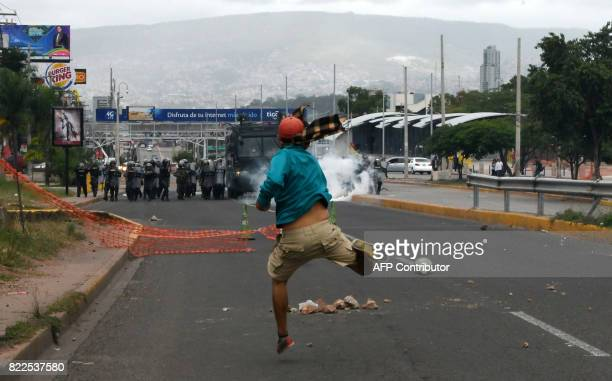 TOPSHOT A student of the National Autonomous University of Honduras gathered under the University Student Movement clashes with the riot police...