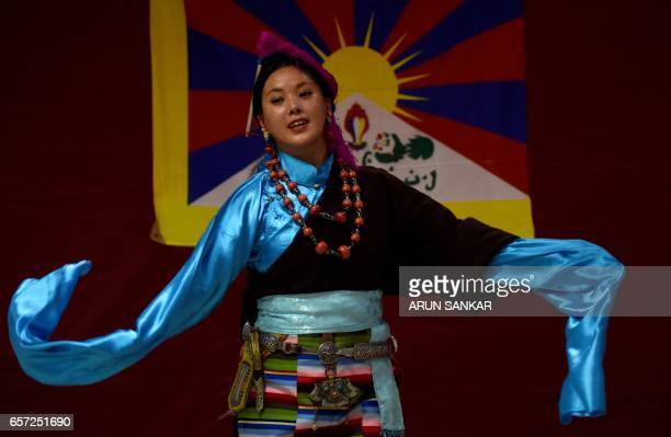 A student of The Tibetan Institute of Performing Arts performs a dance during a cultural event in Chennai on March 24 2017 / AFP PHOTO / ARUN SANKAR