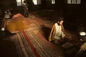 A student of theology reads a Qoranic text at Ayatollah Golpaygani seminary in the holy city of Qom Iran 1st February 1994