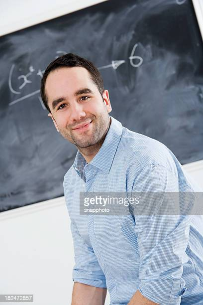 Student or Teacher in Front of School Chalkboard