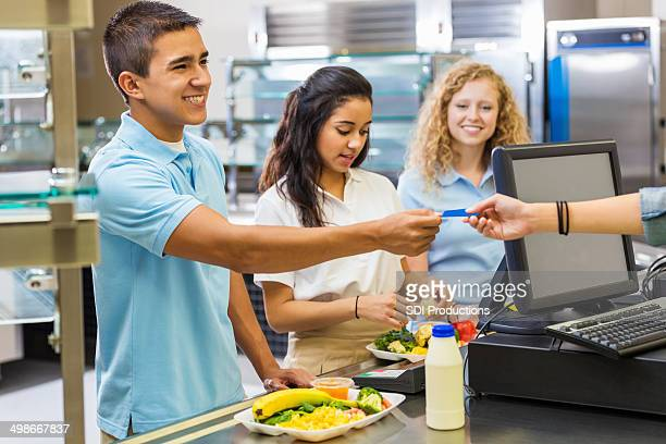 Student paying for cafeteria hot lunch with card