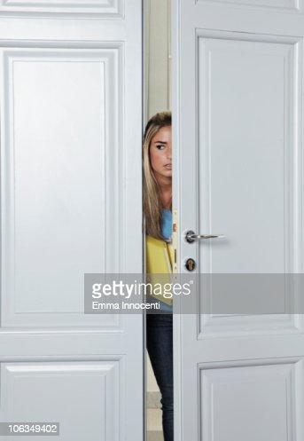 Student peeking though door