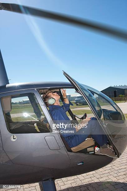 Student pilot checking interior of helicopter