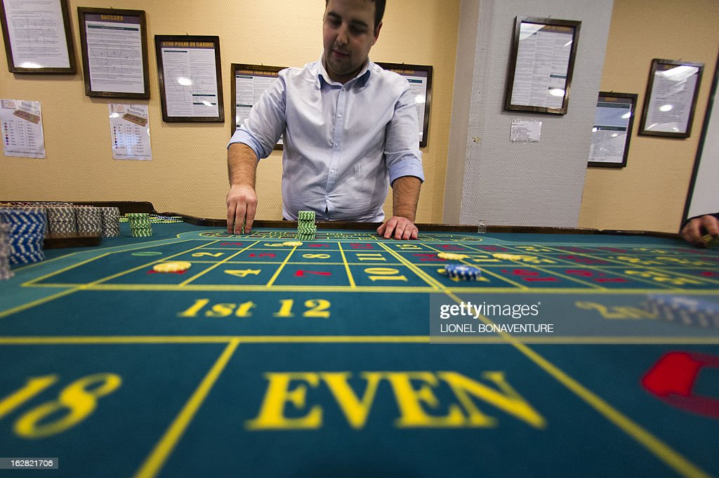 A student places tokens on a roulette table in the Cerus Casino Academy, a school for croupiers in Paris, on February 27, 2013.