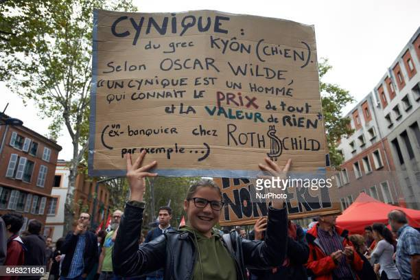 A student poses with a placard reading 'A cynic knows everything' price but the worth of nothing' citing Oscar WildeMore than 10000 protesters took...