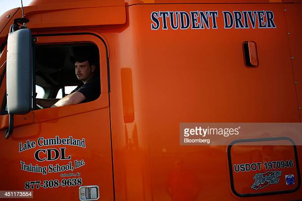 A student practices hooking an 18 wheeler up to a trailer during a commercial drivers license class at Lake Cumberland CDL Training School in Mt...