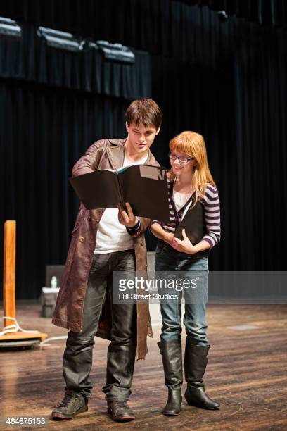 Student practicing lines on stage