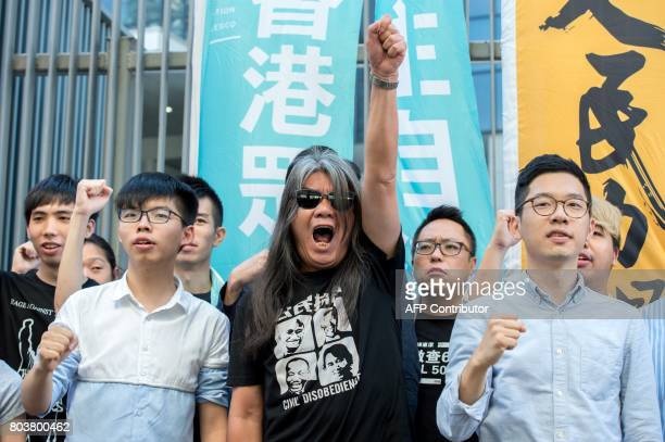 Student protest leader Joshua Wong prodemocracy lawmaker Leung Kwokhung also known as 'Long Hair' and prodemocracy lawmaker Nathan Law hold a protest...