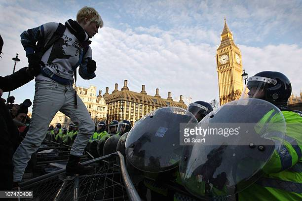 A student protester stands on a barrier in Parliament Square on December 9 2010 in London England Parliament is voting today on whether to implement...