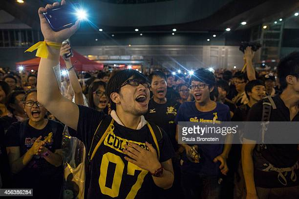 Student protesters shine lights as they chant prodemocracy slogans on the streets on September 30 2014 in Hong Kong Hong Kong Thousands of pro...