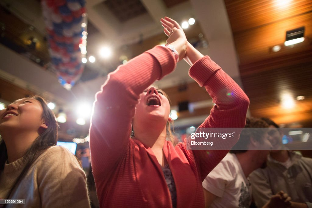 A student reacts as she watches election returns come in inside the Kennedy Forum at the Harvard University John F. Kennedy School of Government in Cambridge, Massachusetts, U.S., on Tuesday, Nov. 6, 2012. Barack Obama, the post-partisan candidate of hope who became the first black U.S. president, won re-election today by overcoming four years of economic discontent with a mix of political populism and electoral math. Photographer: Scott Eisen/Bloomberg via Getty Images