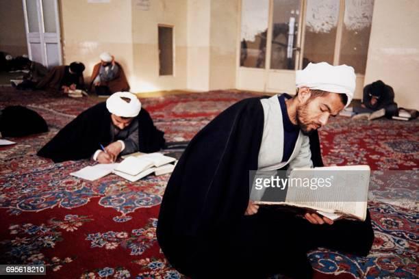 Student read a Koran prior to praying in June 1988 at Faezieh Islamic school of theology in Tehran Iranian leader Ayatollah Rudollah Khomeini taught...