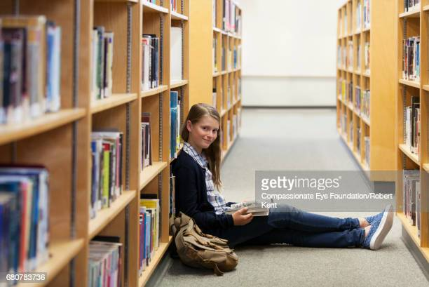 Student reading in library