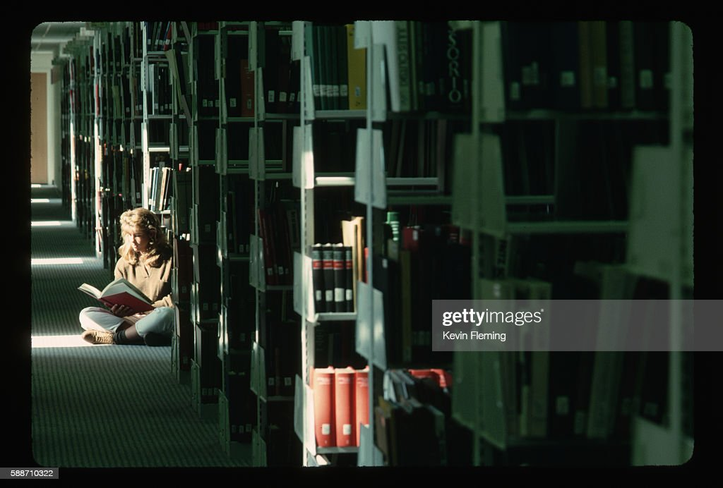 Student Reading in University Library