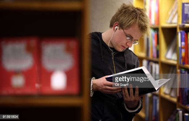 A student reads a textbook in Blackwell bookshop as Oxford University commences its academic year on October 8 2009 in Oxford England Oxford...