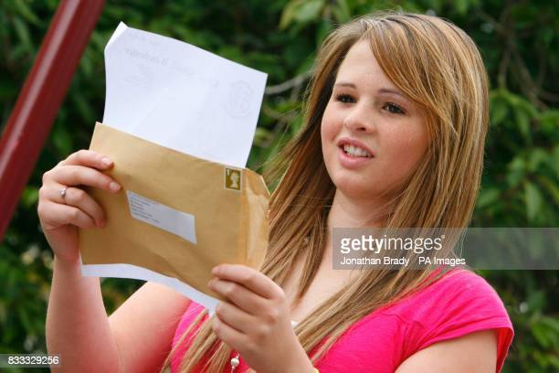A student receives their GCSE results at Kings' School in Winchester Hampshire