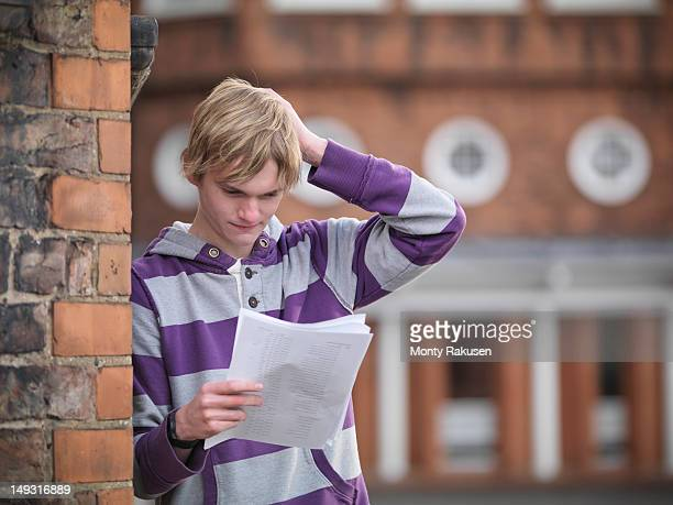 Student receiving unsuccessful exam results at school