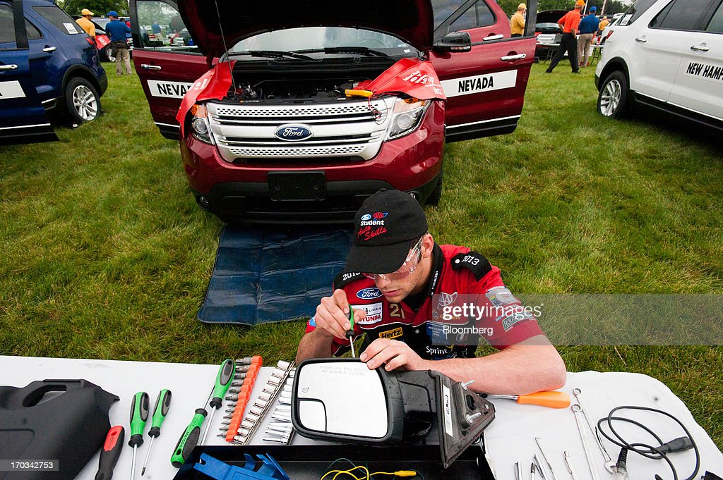 A student repairs the mirror of a Ford Motor Co. Explorer at the National Finals of the Annual Ford/AAA Student Auto Skills Competition at the Ford World Headquarters in in Dearborn, Michigan, U.S., on Tuesday, June 11, 2013. Job openings in the U.S. fell in April, showing companies were waiting to assess the effects of higher taxes and reduced government spending before committing to bigger staff increases. Photographer: Ty Wright/Bloomberg via Getty Images