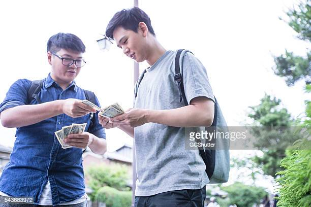 Student returning the borrowed money.