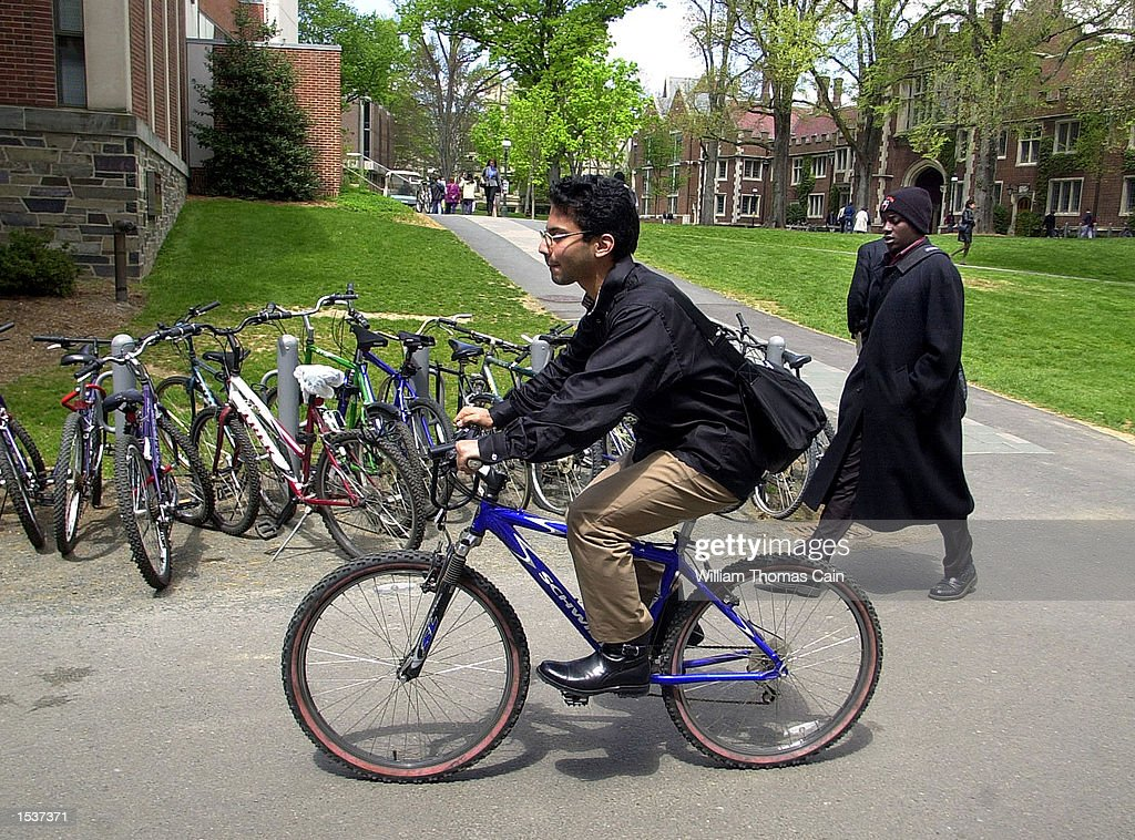 A student rides his bicycle home from class on the campus of Princeton University April 23 2002 in Princeton NJ Twentysix percent of the student...