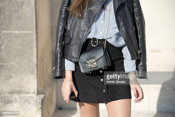 Student Rita Antonio wears a Zara jacket top skirt and Furla bag on day 5 during Paris Fashion Week Spring/Summer 2016/17 on October 3 2015 in Paris...