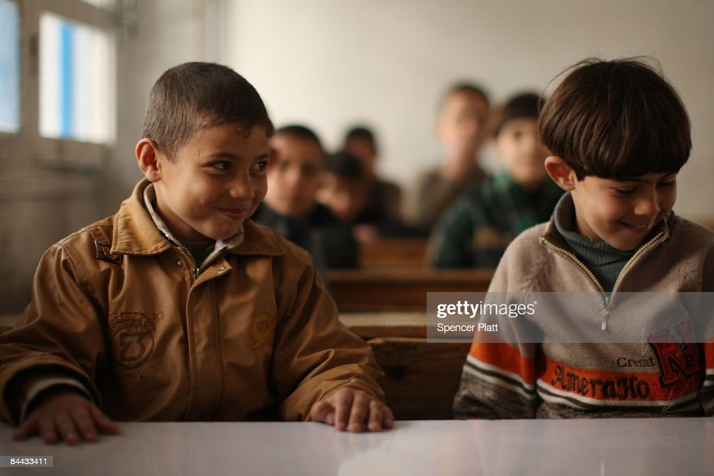 Student sit in class at Jabalia Prep C Boys School on the first day back to school since the ceasefire with Israel January 24 2009 in Jabalia Gaza...