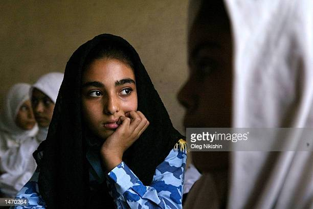 A student sits in class during a lesson at a girls primary school October 10 2002 in Basrah Iraq United Nations Secretary General Kofi Annan...